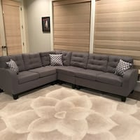 Grey New Sectional. Comes in 2 large boxes. New Montgomery, 36107