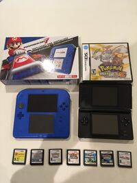 blue Nintendo 3DS with game cartridges 1311 km