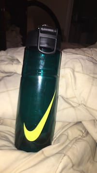 green and yellow Nike sports tumbler