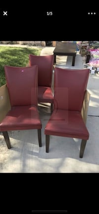 Three Red Ashley Furniture vinyl chairs- structurally sound but vinyl is peeling Las Vegas, 89128