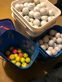 white and green golf balls