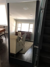 Full length mirror with brown wood trim. Toronto, M6S 2M8