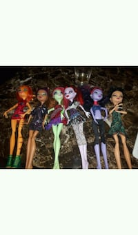 assorted color dressed doll collection