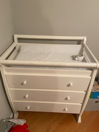 Changing table and a dresser with pad