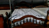 brown wooden bed frame with white mattress Bakersfield, 93305