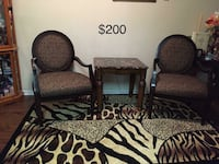 two brown wooden framed armchairs College Park