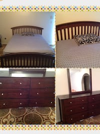 two brown wooden bed frames Houston, 77036