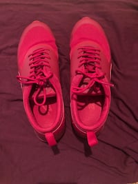 Pair of RED nike running shoes SIZE 9 in WOMENS Houston, 77064