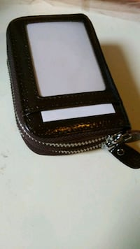 black and white leather wristlet Montréal, H2K 3P6