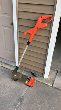 orange and black electric string trimmer Amana, 52307