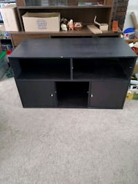 "Black tv stand 49 3/4""Length 23"" wide"