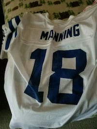 white and blue Manning 18 jersey shirt