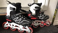 Pair of black-and-white inline skates Mississauga, L5N 7V1