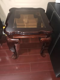 Brown wooden framed glass top coffee table, In okay condition Brampton, L6P 0K9