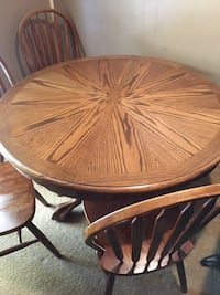 """48"""" round pedestal base. Has 24"""" leaf and 4 chairs"""