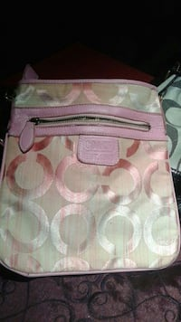 gray and pink Coach sling bag