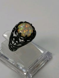 White Fire Opal. sz 5 Mount Pleasant, 48858