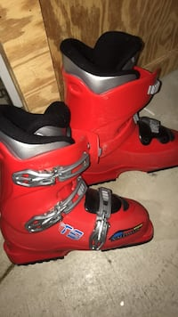 pair of red-and-black snowboard boots Duryea, 18641