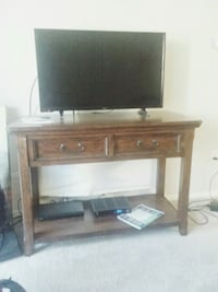 brown wooden TV stand with flat screen television Anaheim, 92801