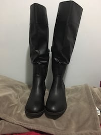 pair of black leather knee high boots Toronto, M9V 3C9
