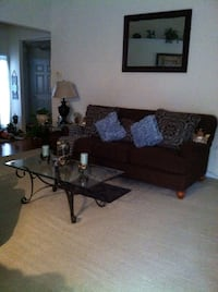 Brown fabric sofa and chair . Comes with 2 sets of pillows. One set all blue and the other brown and blue . Newnan, 30263