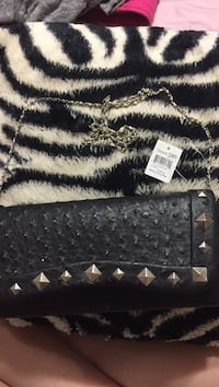 black and gray leather wristlet Metairie, 70003