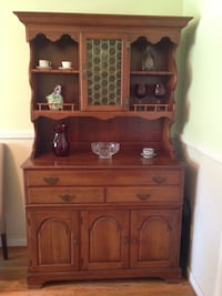"Pennsylvania house cherry hutch and 102"" table with 3 leaves good condition no chairs with pads. Or best offer Mount Airy, 21771"