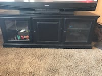 black wooden TV stand with cabinet 2057 mi