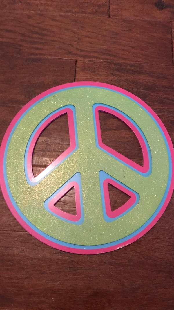pink and green peace sign decoration