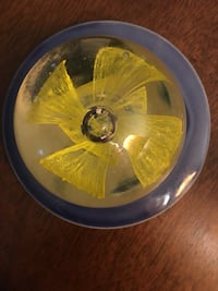 Glass Paperweight Encased w/Yellow Flower Gainesville