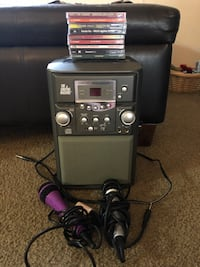 Karaoke Machine with 2 microphones & 9 CDs to sing to.