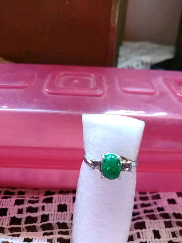 silver-colored green gemstone ring