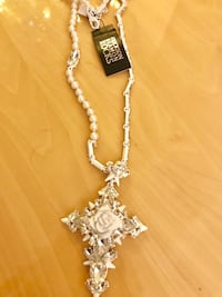 white beaded necklace with cross pendant