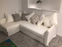 White leather sectional sofa with throw pillows Calgary, T3M 2M8