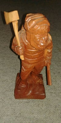 brown wooden man holding sword figurine Saint Thomas, N5P 4K9