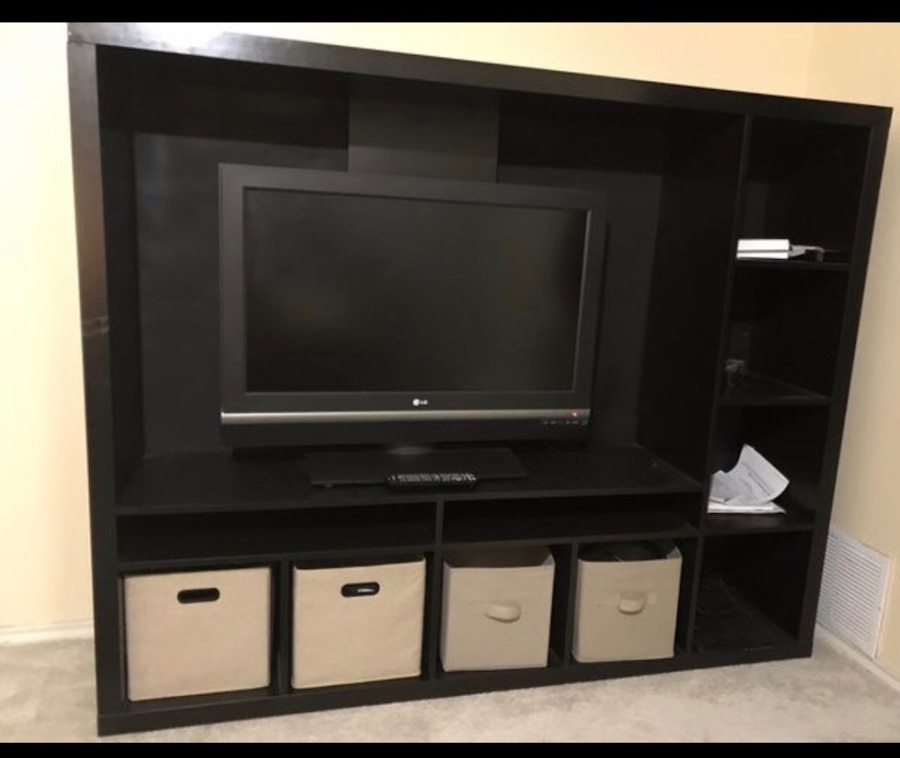 black flat screen TV with brown wooden TV hutch for sale  Garland