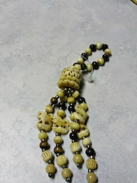 brown and black beaded accessory