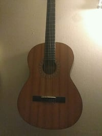 brown and black classical guitar