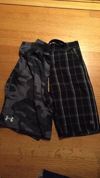 Boys shorts -Hurley/under armour size large/12 New Westminster, V3L 4P8