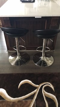 two round black leather bar stools Burnaby, V5C 3J8
