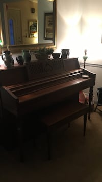 brown wooden upright piano Wilmington, 19810