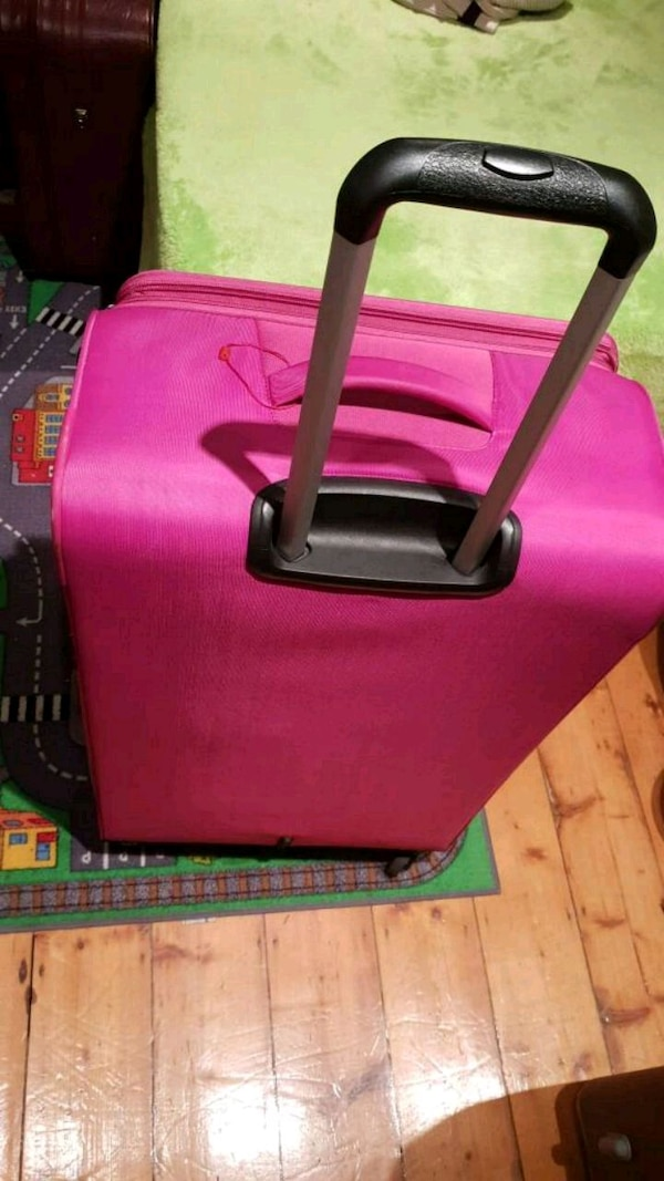 pink and black leather tote bag