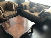 Brown wooden framed brown padded sofa with coffee table and two side tables Surrey, V3T 3R7