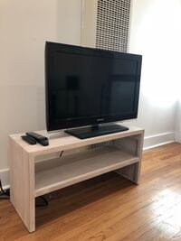 flat screen TV and white wooden TV stand 2273 mi