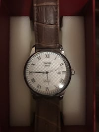 Round silver analog watch with brown leather strap Albuquerque, 87105