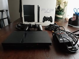 PlayStation 2 - Four games included.