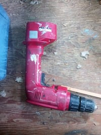 red and black Milwaukee cordless power drill 150 mi