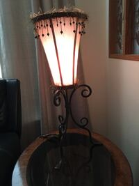 Very interesting lamps with feathers and beads on shade with wrought iron base. Very Unique  Richland, 99352