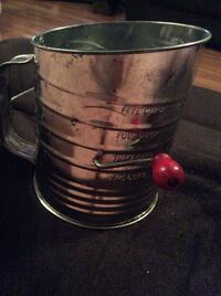 Vintage sifter. With red ball handle