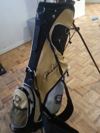 John Daly  gold Colf clubs
